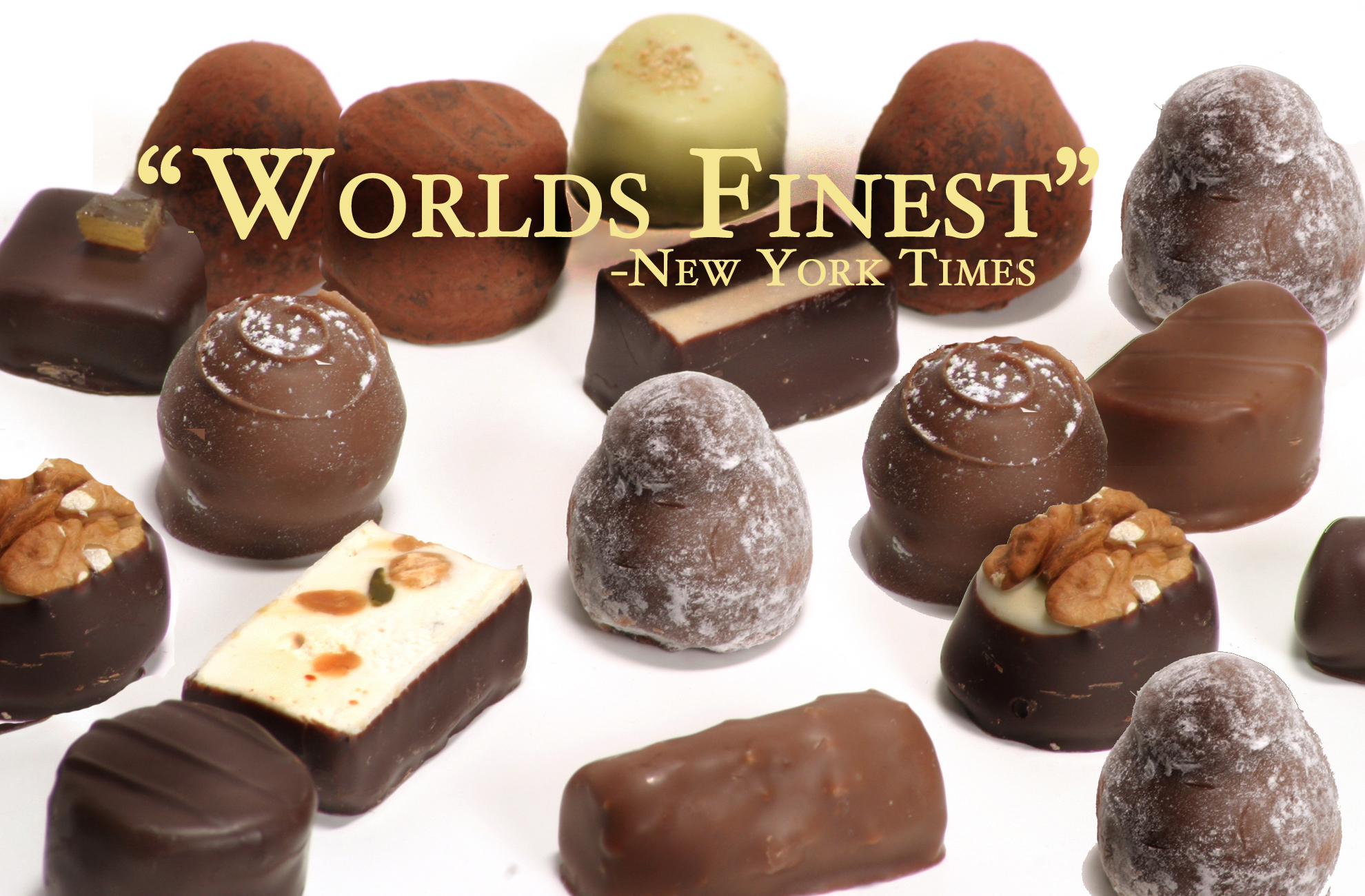 Picture shows an array of Teuscher Chocolate truffles on a white background with overlayed script reading World's Finest, New York Times.